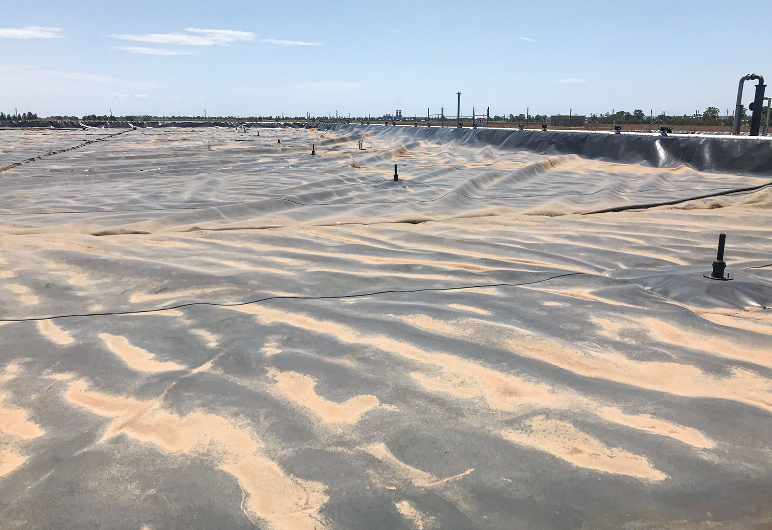 Bacteria produce biogas in this covered lagoon