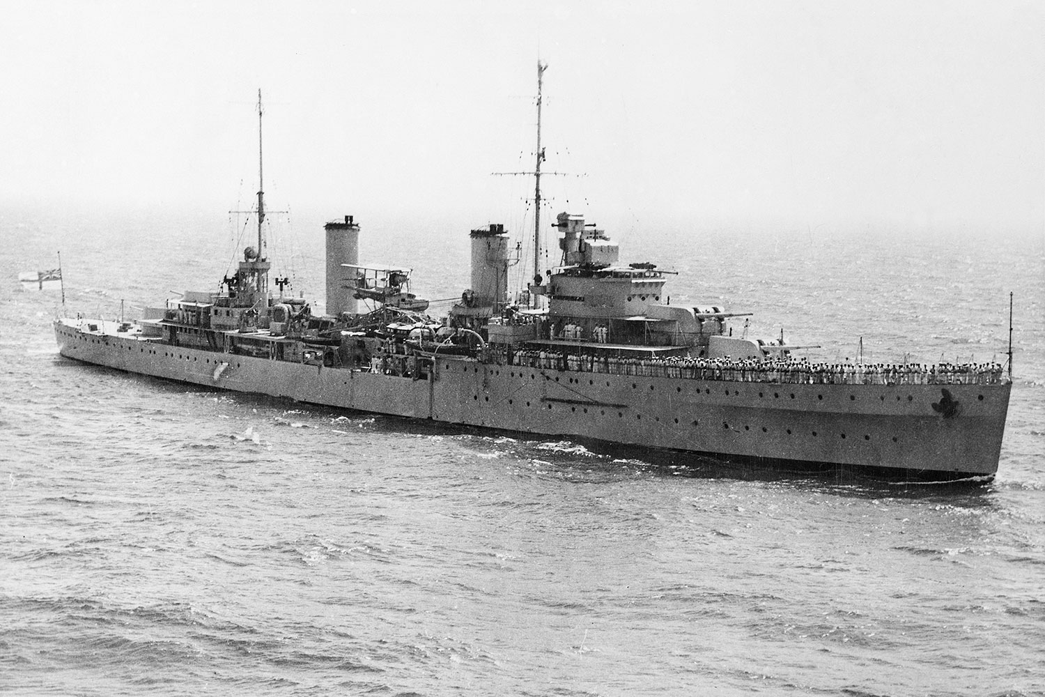 An aerial starboard bow view of the cruiser HMAS Sydney (II)