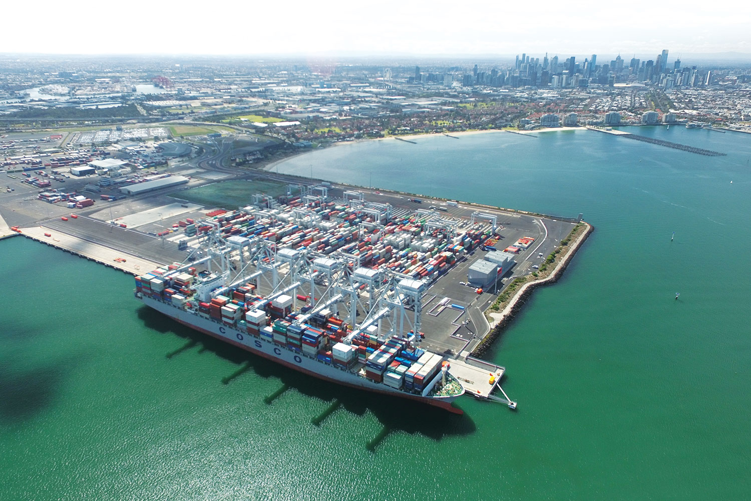largest ship to arrive at automated container terminal