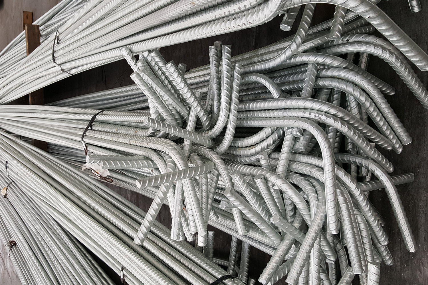 Hot dip galvanized reinforcement for increased durability in concrete construction.