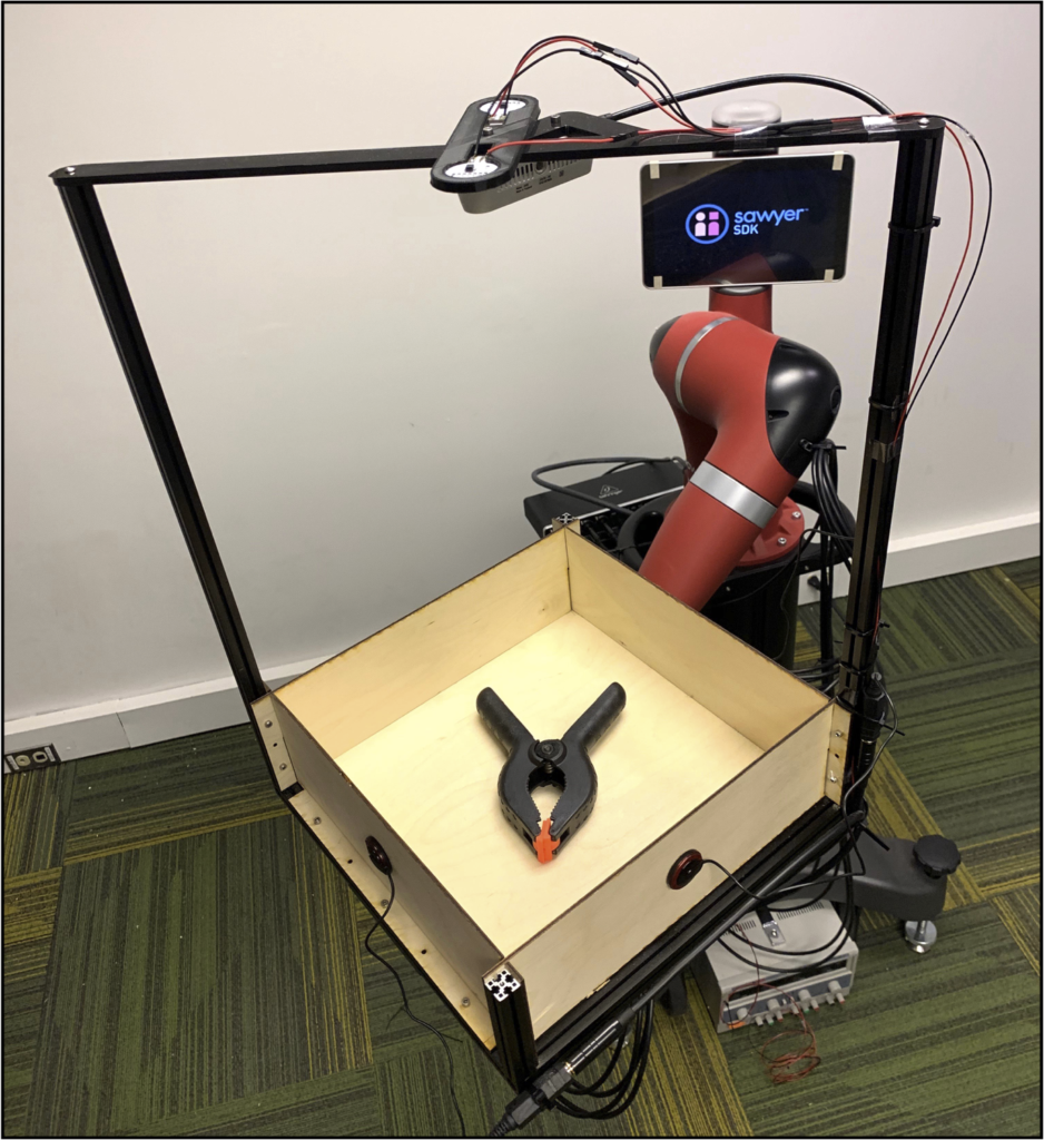 The researchers developed the Tilt-Bot, which is a square tray attached to the arm of a Sawyer robot.
